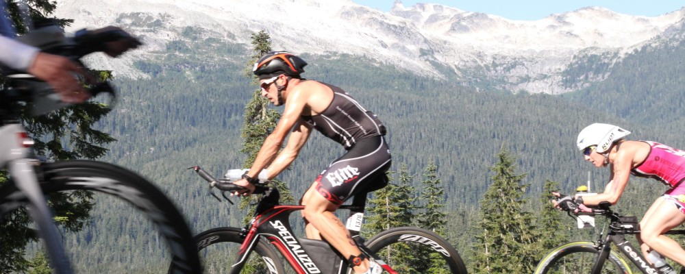 IRONMAN Canada TEAM ELITE triathlete competing on the bike